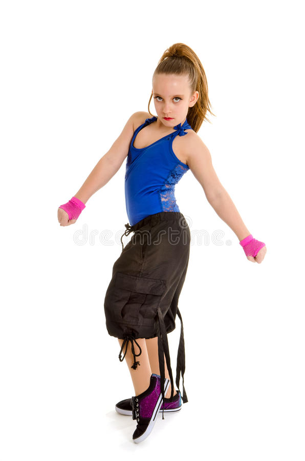 Fierce HipHop DancerGirl. A Fierce Young Girl Poses as a Hip Hop Dancer with Attitude royalty free stock image