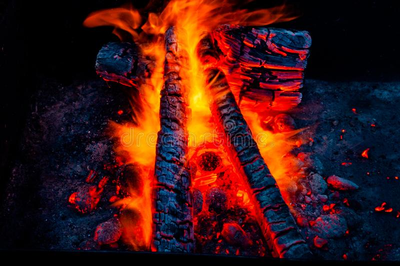 Fiery background. Live coals. Burning firewood royalty free stock photos