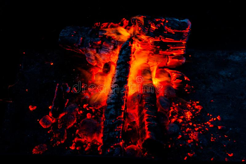 Fiery background. Live coals. Burning firewood. stock photo