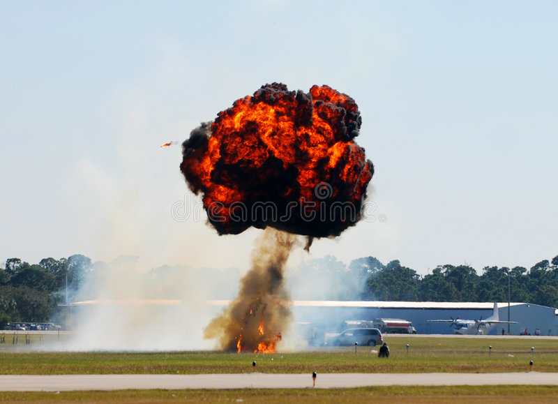 Fiery explosion. Large, flaming mushroom explosion on airport airfield royalty free stock photos