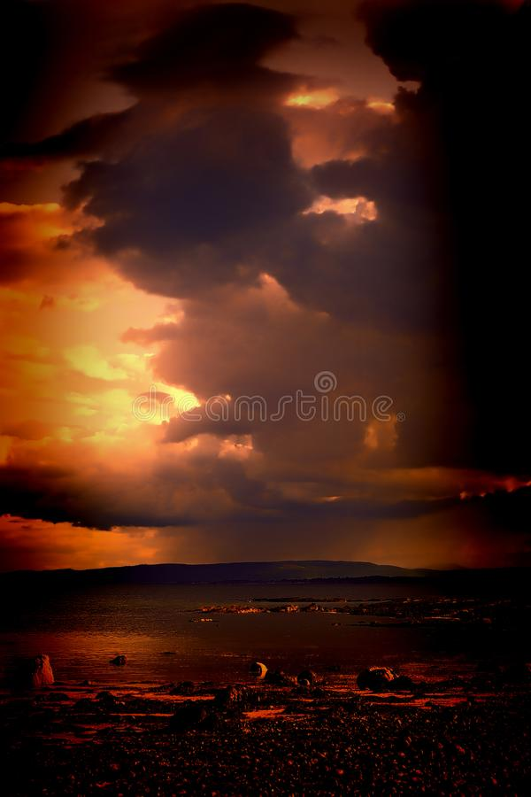 Fiery face in the clouds royalty free stock photo