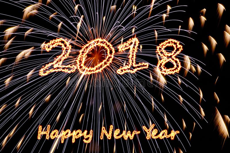 Fiery letters Happy new year 2018 and flashes of fireworks royalty free stock images