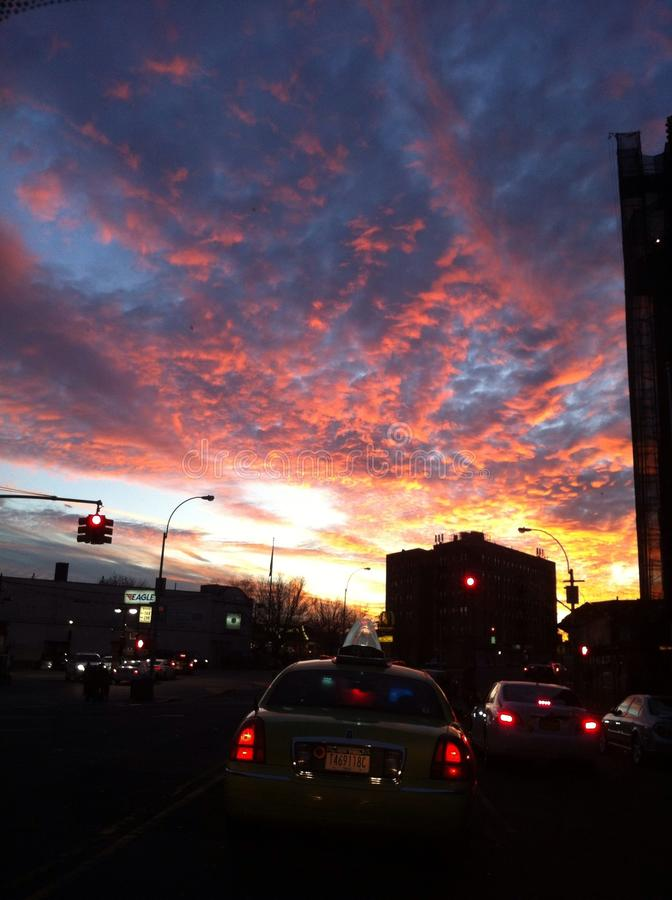 Fiery sky over traffic royalty free stock photos