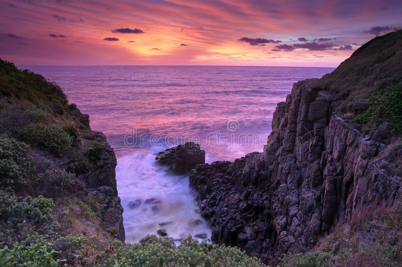 Fiery sunrise skies at Minamurra Headland South Coast Australia stock images