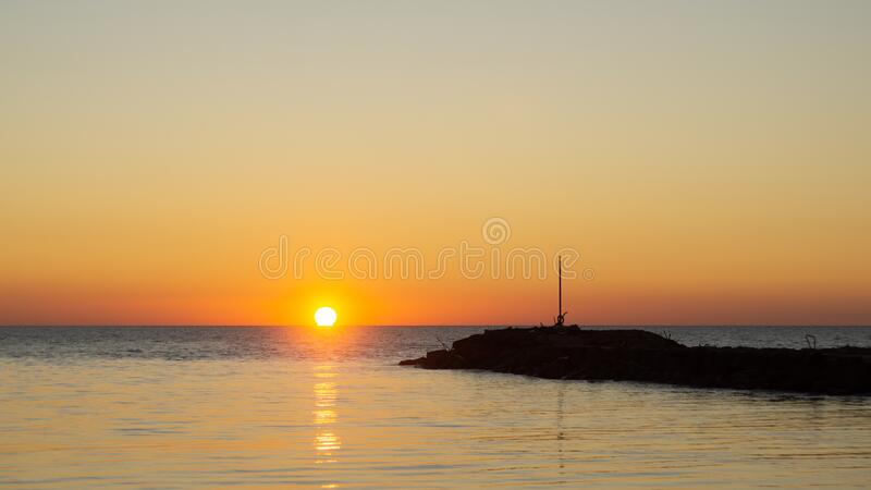 Fiery sunset over the Sea with Pier stock photography
