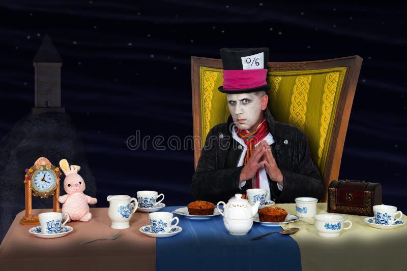 Fiesta del té con el sombrerero enojado imagen de archivo libre de regalías