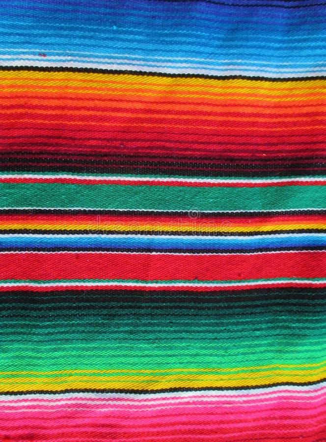 Poncho background Mexican cinco de mayo Fiesta handwoven rug mexico. Poncho Mexican background handwoven rug fiesta with stripes and bright colors cinco de mayo stock image