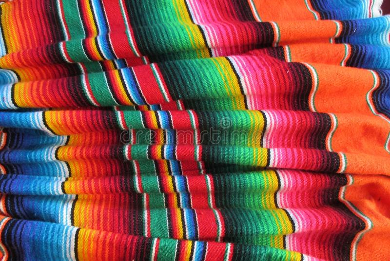 Poncho background Fiesta mexican blanket stock, photo, photograph, image, picture. Poncho Mexican handwoven rug poncho fiesta with stripes and bright colors royalty free stock images
