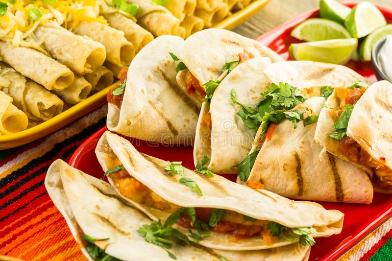 Fiesta buffet table. Fiesta party buffet table with chicken quesadilla and other traditional Mexican food royalty free stock photography