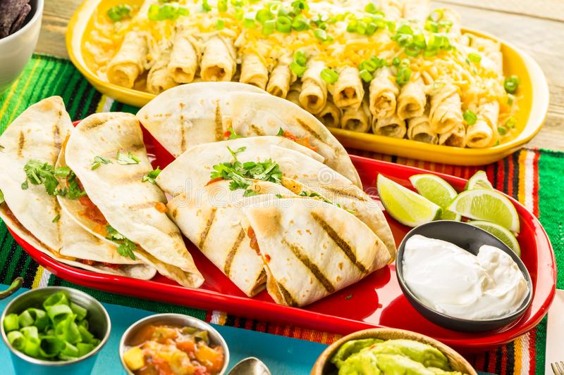 Fiesta buffet table. Fiesta party buffet table with chicken quesadilla and other traditional Mexican food royalty free stock photos