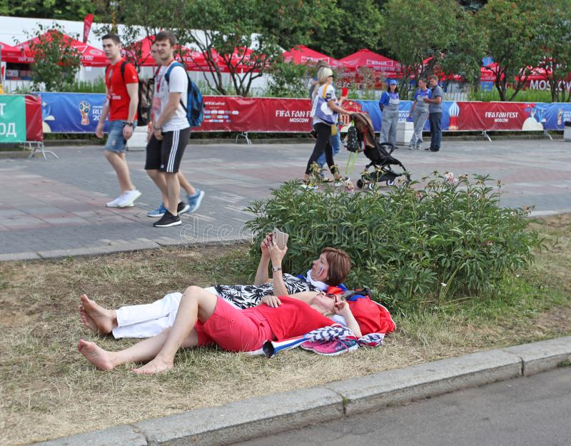 FIFA 2018 fans relaxing on the grass in Fan Zone Sparrow Hills, Moscow, Russia stock photo