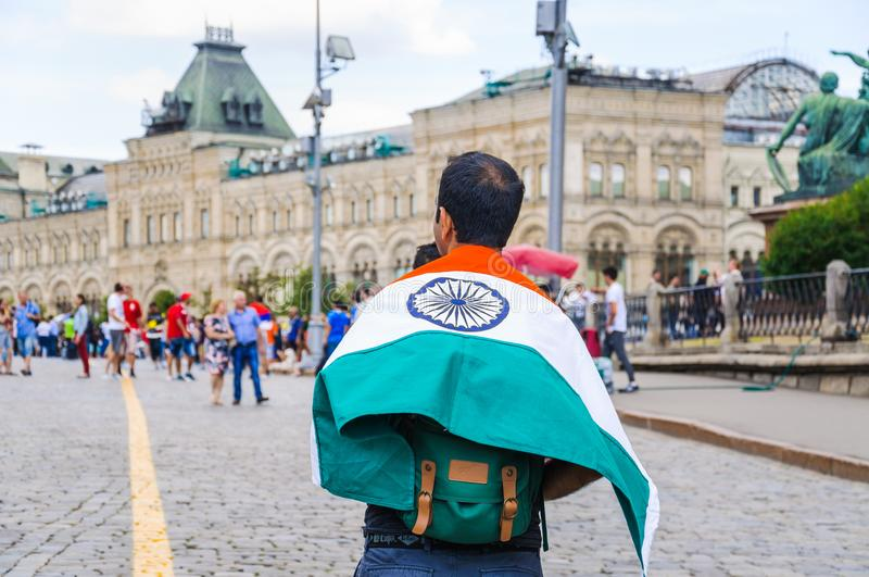 The 2018 FIFA World Cup. Indian tourist with India flag on his shoulders on Red square. MOSCOW, RUSSIA - June 26, 2018: The 2018 FIFA World Cup. Indian tourist royalty free stock photo
