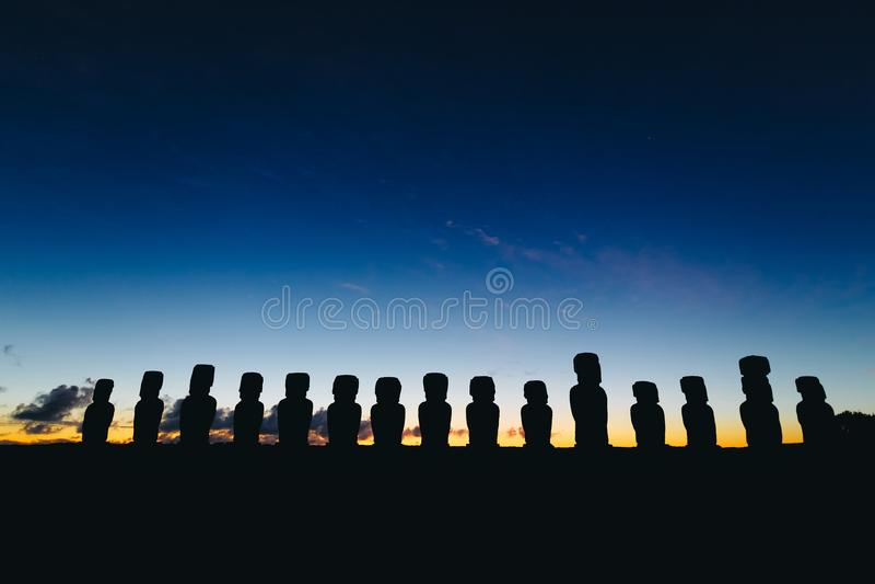 Fifteen standing moai on Ahu Tongariki against dramatic sunrise sky in Easter Island. Chile stock image