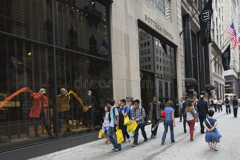 FIFTH AVENUE - NEW YORK CITY. Window shopping and sightseeing are common past times on the upscale sidewalks of Fifth Avenue near Central Park in New York City