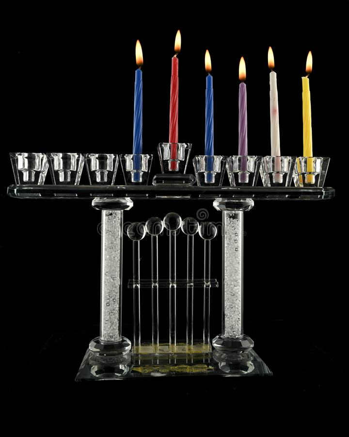 The fifth day Hanukkah menorah crystal lamp. That is lit for eight days of Hanukkah on a black background stock photos