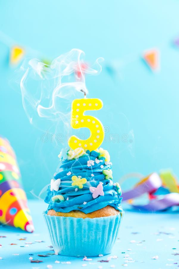 Fifth 5th birthday cupcake with candle blow out.Card mockup. royalty free stock photos
