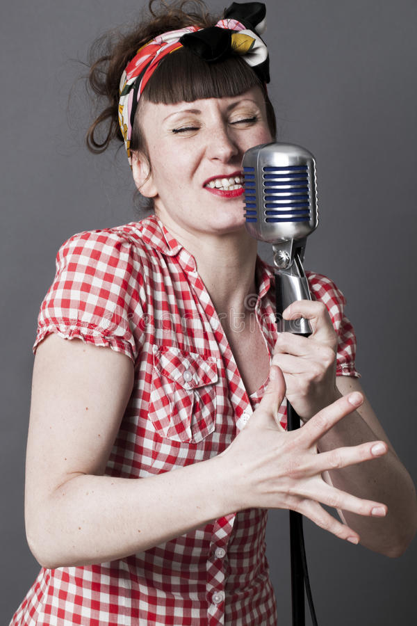Fifties singer in studio for young woman with retro style royalty free stock photo