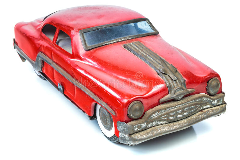 Fifties vintage red car toy isolated on white. Fifties vintage red American car toy isolated on a white background stock photo