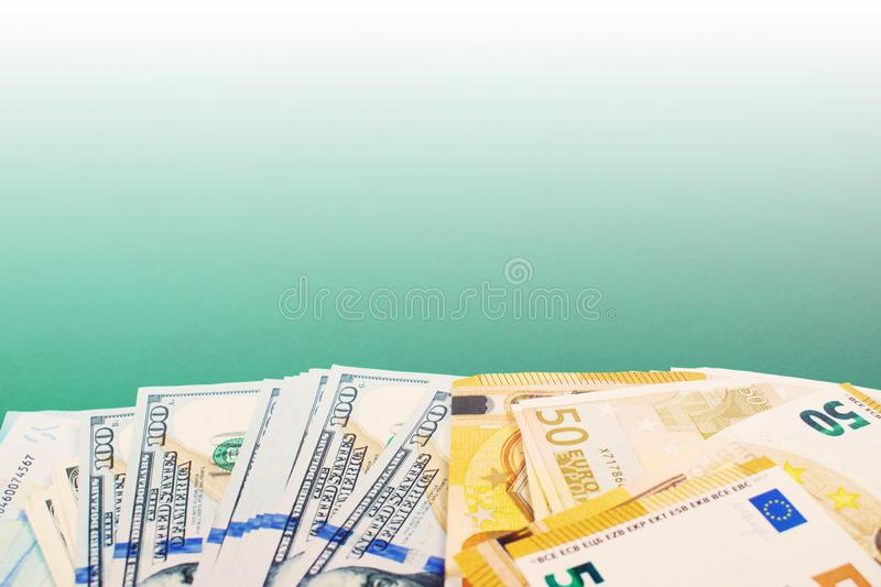 Fifty euro and hundred dollar bills royalty free stock photo