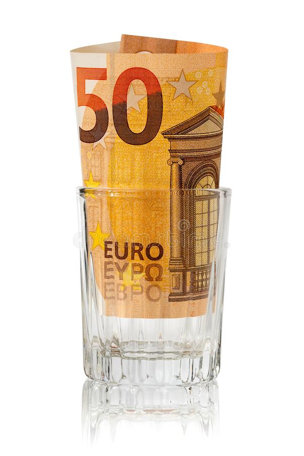 Fifty Euro placed in the alcohol glass stock photo