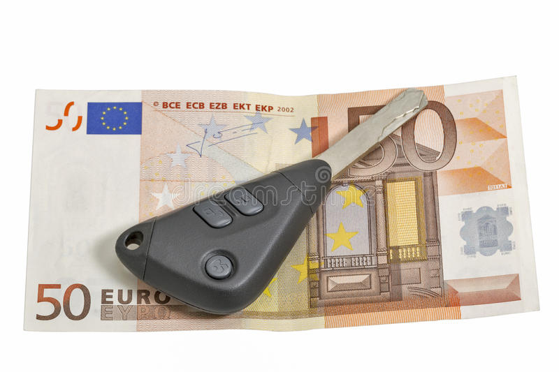 Fifty euros banknote and car keys isolated on white. Closeup with copy space royalty free stock photography