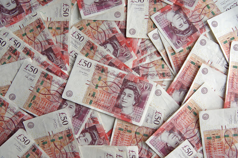 Fifty pound notes. Hundreds of pounds laid out on the table in fifty pound notes. picture good for back ground picture, credit and financial money matters stock photos