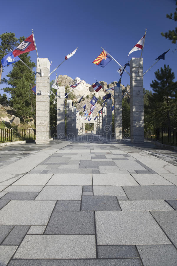 Fifty State flags lining the walkway to Grand Terrace. View of Mount Rushmore National Memorial, South Dakota royalty free stock photo