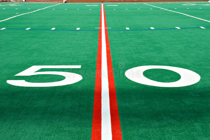 Fifty yard line. The fifty yard line on a highschool football field royalty free stock photo
