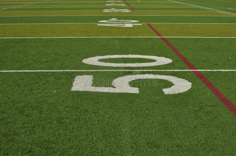 Fifty Yard Line of a Football Field. On Fake Grass stock images