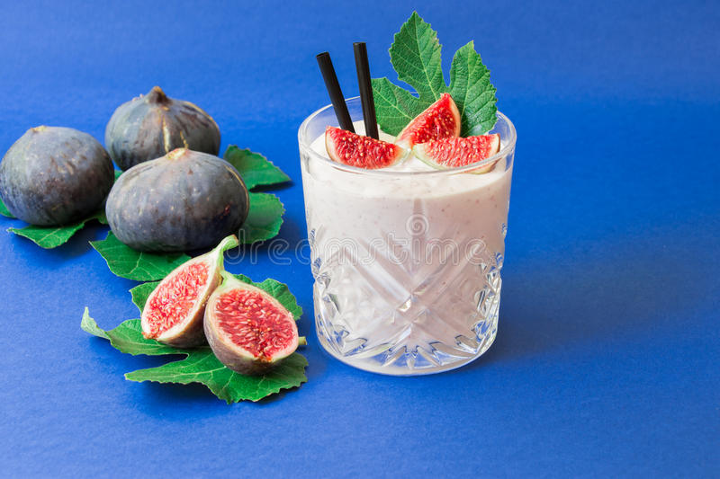 Fig fruit smoothie glass. royalty free stock photo