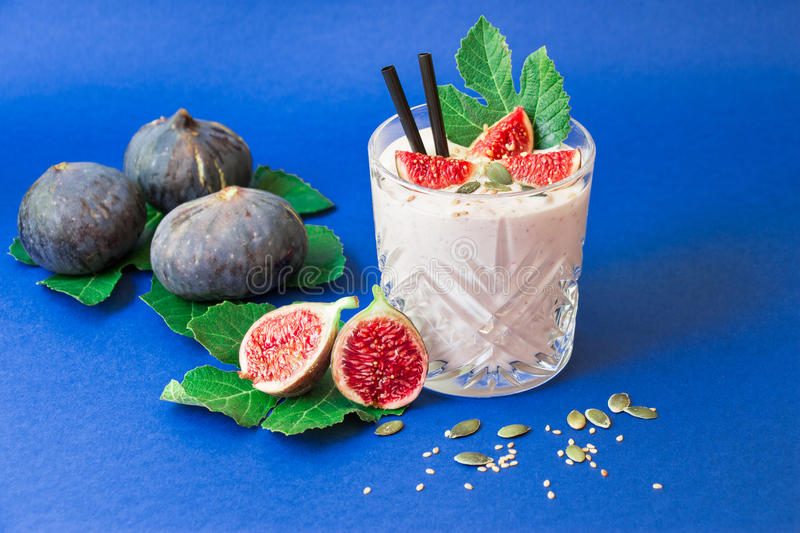 Fig fruit smoothie glass. stock images