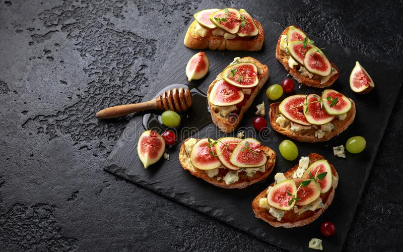 This Fig and Gorgonzola tartines, toast, bruschetta. drizzled with honey. royalty free stock image
