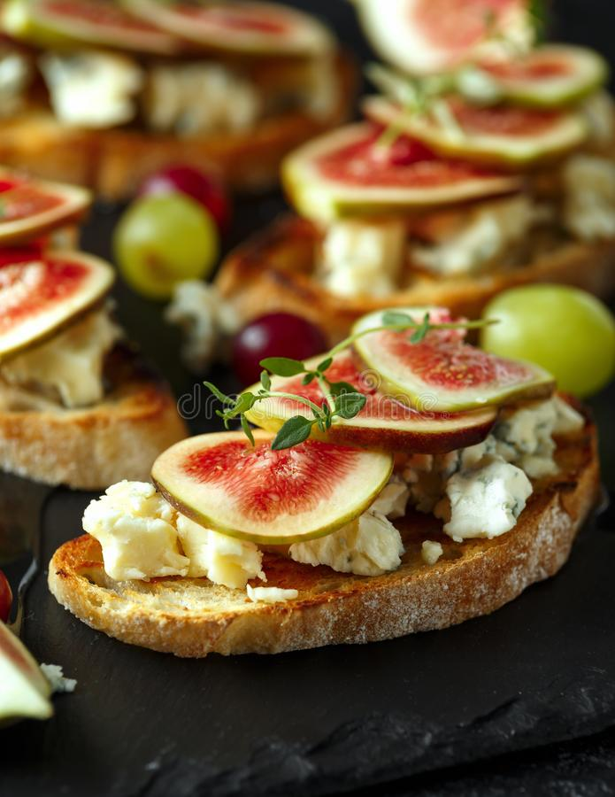 This Fig and Gorgonzola tartines, toast, bruschetta. drizzled with honey. stock photography