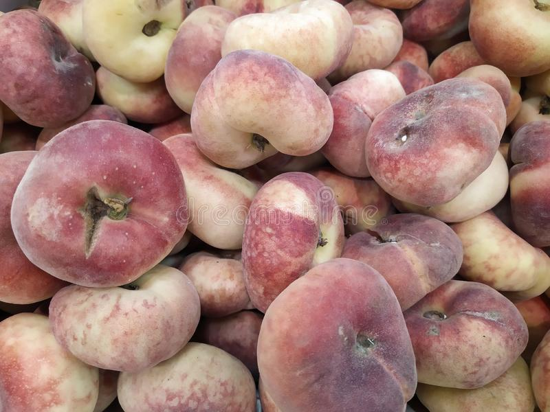 Fig peach, flat peaches. delicious juicy ripe fig peaches background. fresh tasty peaches fruit at farmers. red mature fig peaches stock images