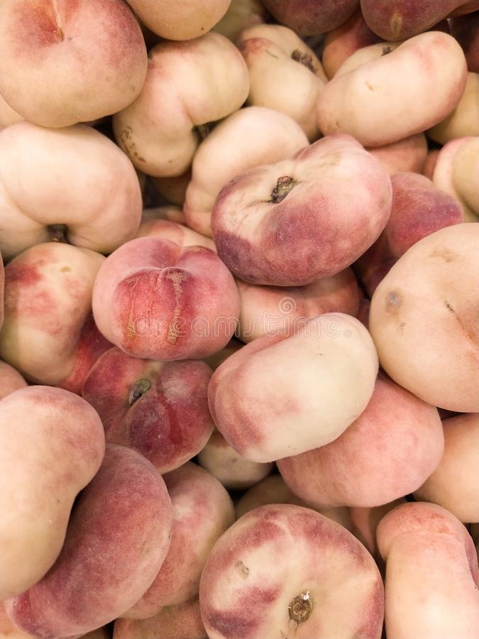 Fig peach. saturn peaches. flat peaches harvest. many peaches. Fresh fruit at farmers` market: peaches. fig peach background stock photo