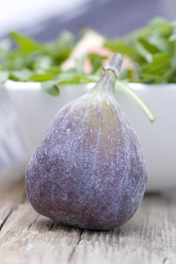 Fig with rocket salad royalty free stock images