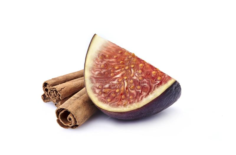 Fig slice with cinnamon isolated on white background royalty free stock photography