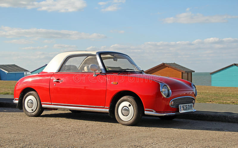 Figaro rojo de Nissan fotos de archivo