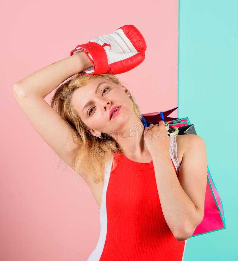 Fight for discount. Woman in boxing glove carry shopping bags. She won discount in battle. Get ready for shopping. Tired stock images