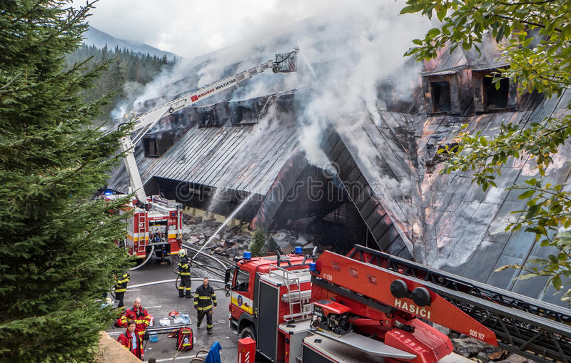 Fight fire at hotel Junior Jasna, Slovajkkia. JASNA, SLOVAKIA - OCTOBER 6: Fight fire in hotel Junior Jasna in Low Tatras mountains on October 6, 2015 in Jasna royalty free stock photography