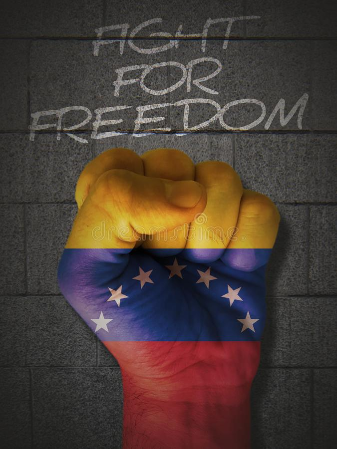 Fight for freedom with the fist and Venezuela flag stock photo