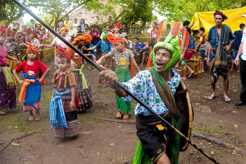 Fighter and dancers at Pasola Festival, Kodi, Sumba Island, Nusa Tenggara stock photos
