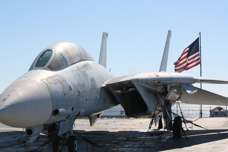 Fighter jet on a carrier deck royalty free stock photos