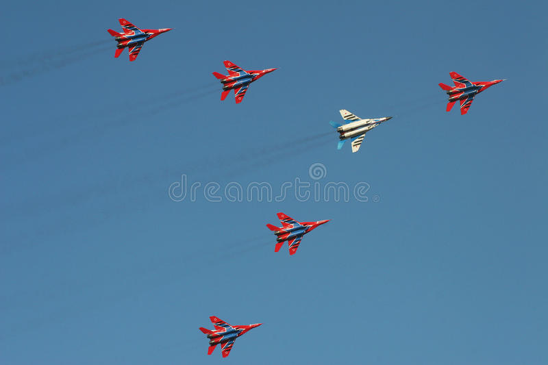 Fighter jet display team at airshow. Fast jets perform at an airshow in Al Ain, United Arab Emirates. Russian fighter jets.Sukhoi SU-35 royalty free stock photo