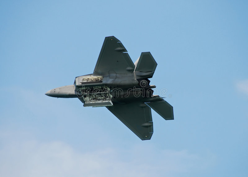 Fighter jet in flight stock images