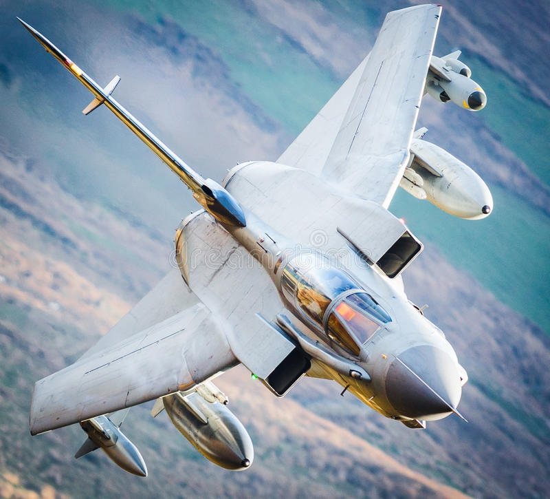 Fighter jet in flight stock photography