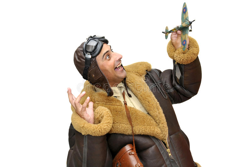 Fighter pilot. With model plane isolated in white royalty free stock photo