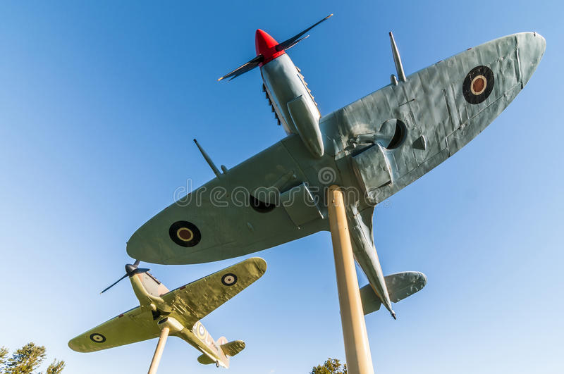 Fighter planes on a stick. Spitfire and Hurricane vintage figther plane on Jackson park windsor ontario canada royalty free stock images