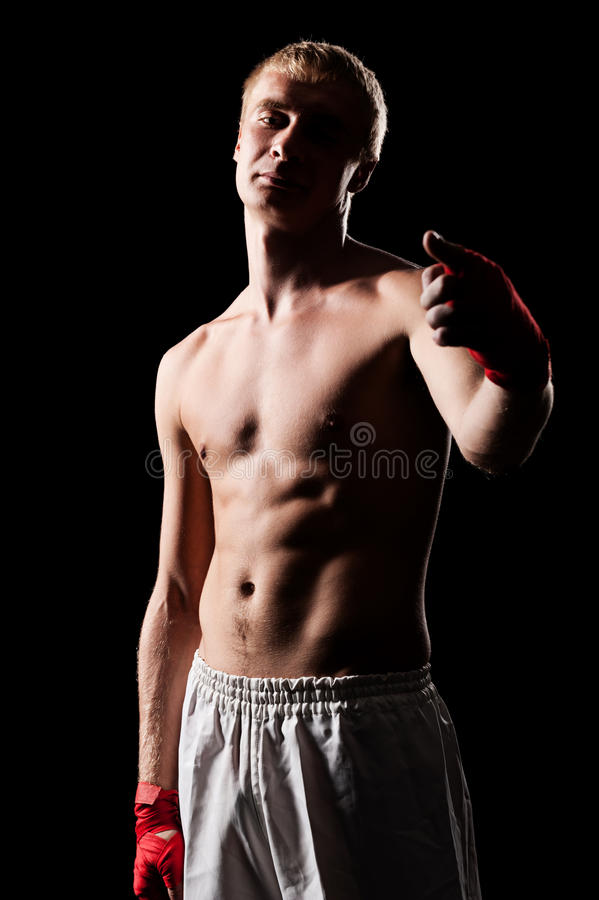 Download Fighter pointing at you stock photo. Image of shorts - 26703034