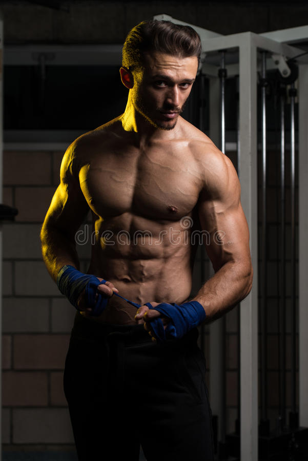 Fighter Putting Blue Straps On His Hands royalty free stock photo